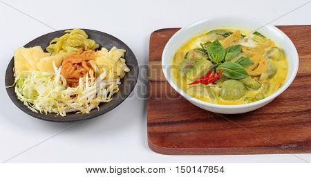 Green fermented flour curry  with  mixed herb ,green fermented flour curry  with  mixed vegetable served side disk.
