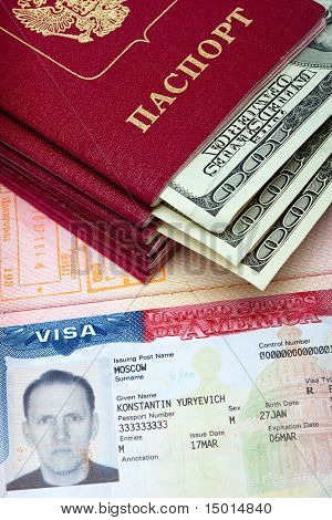 The American visa on page of the Russian international passport and the passport with the enclosed U