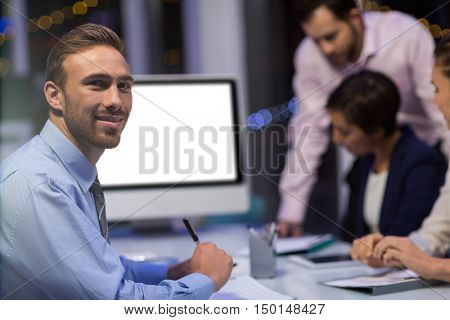 Portrait of smiling businessman in conference room at office