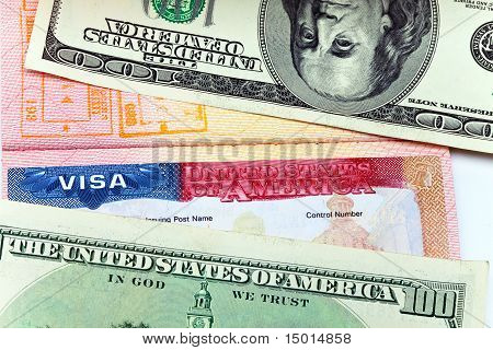 The American visa on page of the international passport and US dollars