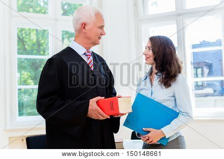 Lawyer and paralegal in their law office