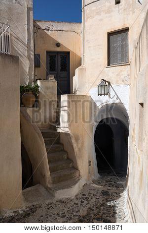 Typical narrow street in Santorini island Greece