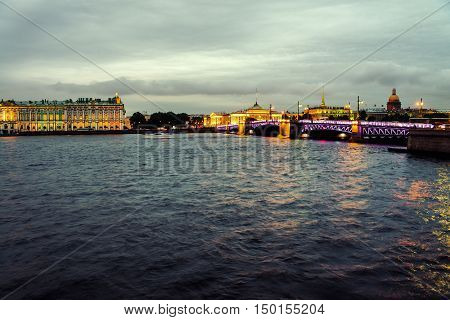 Nightlife in Saint Petersburg with illuminated historical buildings and Neva river