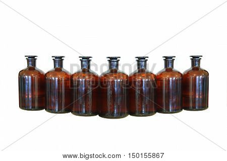 Chemical reactants in glass capacities stand on a regiment in chemical laboratory.