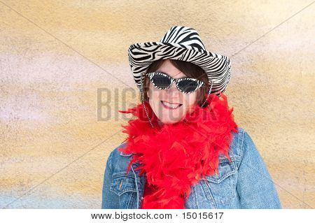 Caucasian Woman Wearing Retro Hat And Feather Boa