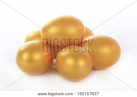 the a gold eggs on a white background