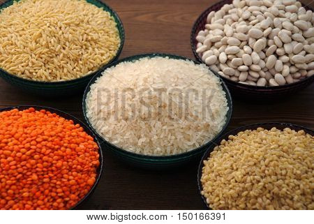 various cereals and legumes in bowls, Rice, Lentils, and barley noodles