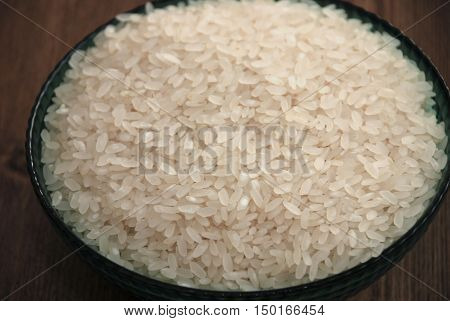 bowl of rice grains.Rice - Cereal Plant, Rice - Food Staple, Cereal Plant, Bowl, Directly Above