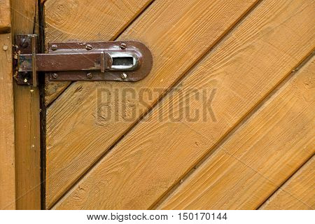 Steel pad bolt on shed wooden door