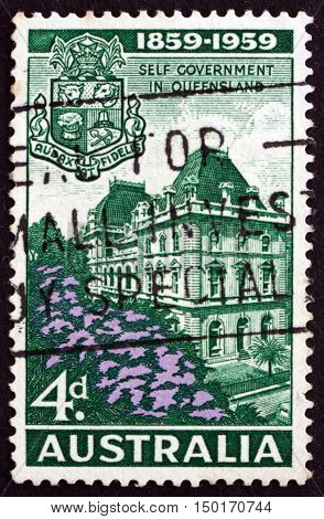 AUSTRALIA - CIRCA 1959: a stamp printed in Australia shows Parliament House Brisbane and Queensland Arms Centenary of Queensland Self-government circa 1959