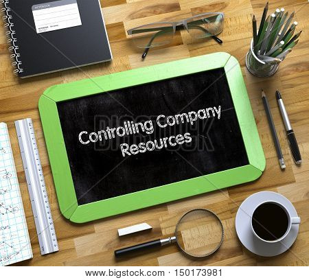 Controlling Company Resources - Text on Small Chalkboard.Controlling Company Resources - Green Small Chalkboard with Hand Drawn Text and Stationery on Office Desk. Top View. 3d Rendering.