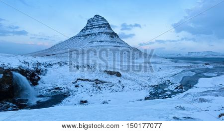 The Kirkjufell mountain in winter at twilight, Snaefellsnes , Iceland.