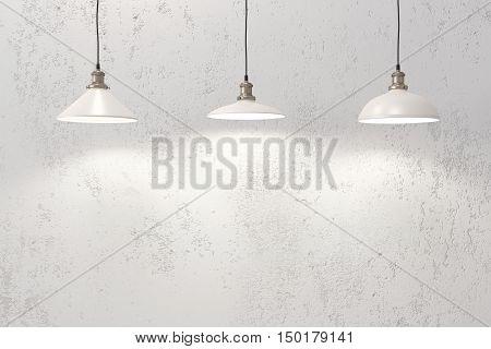 Industrial loft pendant lamps against rough wall