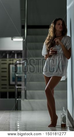 Girl In Depression Drinking Alcohol In Solitude
