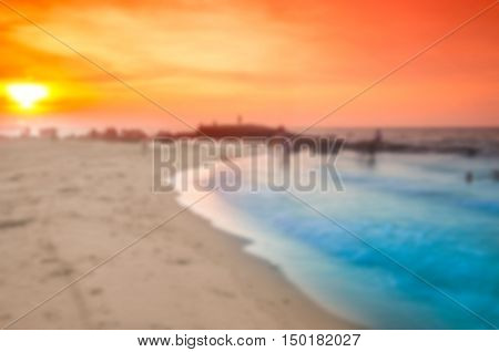 Blurred sunset at sea witj sunset time