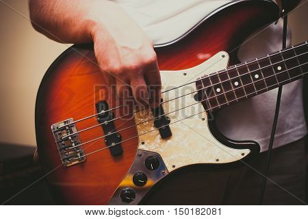 Detail Of Man Playing Bass Instrument