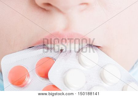 Closeup Of Woman With Blister Of Pills
