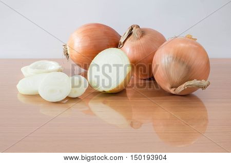 Sliced Fresh Onion On Table Reflection