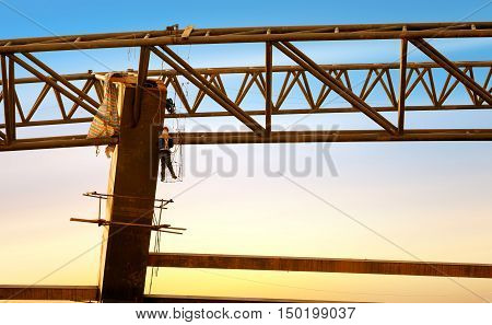 Urban modern construction site, workers at high altitude