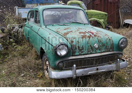 Port Baikal Russia - Oct 11 2014: Old rusty car brand Moskvich in the yard