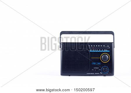 black vintage retro style AM, FM portable radio transistor receiver on white background  isolated