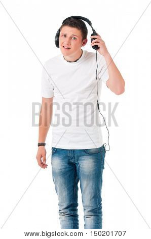 Teen student boy with headphones listening music. Guy looking at camera, isolated on white background. Portrait of young man - studio photo.