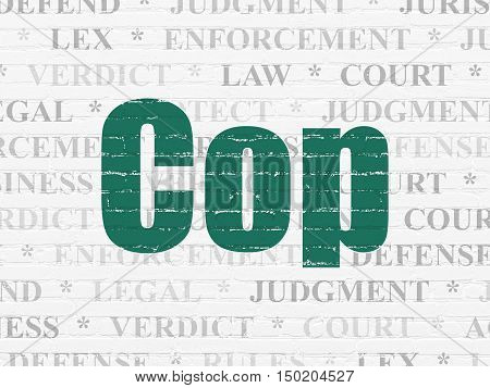 Law concept: Painted green text Cop on White Brick wall background with  Tag Cloud
