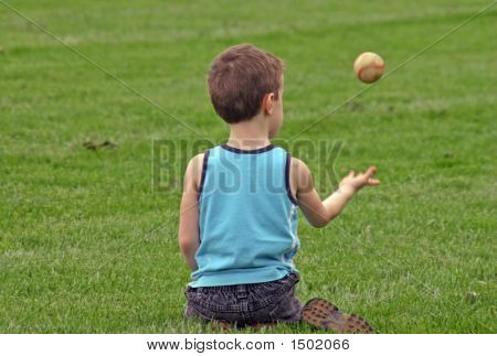 Boy Tossing Baseball