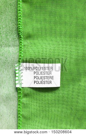 Fabric composition label on green cloth as a background