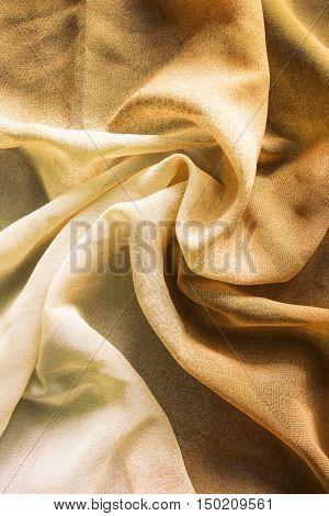 Draped yellow chiffon closeup as a background