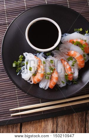 Japanese Food: Shirataki With Prawns, Spring Onions And Soy Sauce Close-up. Vertical Top View