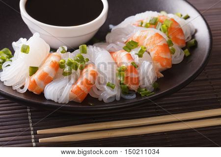 Shirataki Noodles With Shrimp, Green Onions And Soy Sauce Close-up. Horizontal