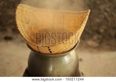 Steaming traditional sticky  rice  : Steaming bamboo basket and steaming pot, cooked sticky rice