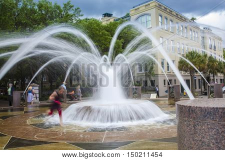 Motion blur of kids playing in the fountain in downtown Charleston, South Carolina