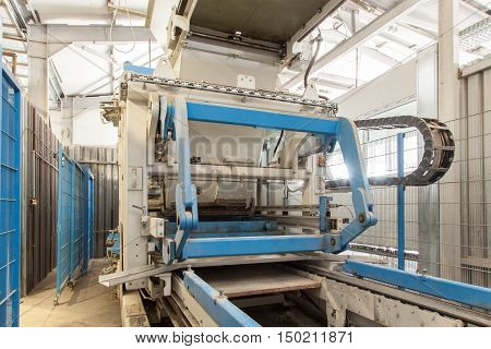 Modern equipment at factory. Process of producing concrete blocks