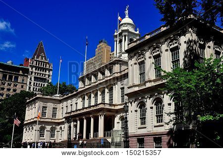 New York City - August 13 2013: South facade of 1811 City Hall in lower Manhattan with its portico graceful windows and cupola topped by a statue of Justice