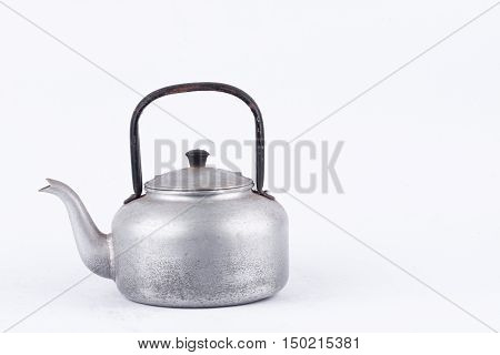 old vintage retro Kettle on white background drink isolated . Which, kettle made of aluminum.