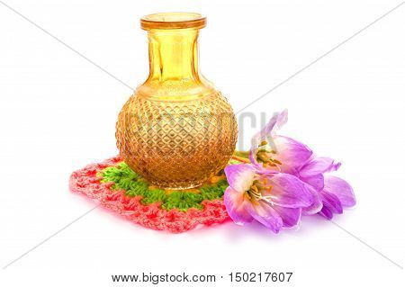 Flower Colchicum flower gorgeous next to a vase isolated on white background