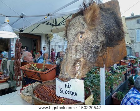 ORIOLO ROMANO, ITALY - SEPTEMBER 25, 2016: Hunting trophy boar head appended at market stand with the occasion of Porcini Mushroom Festival.
