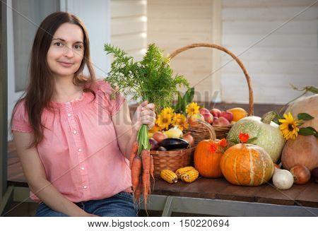 Grower rich harvest of vegetables, nice girl gardener huge harvest for Thanksgiving