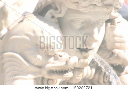 Art background with detail of Rome fountain with an intentional blur effect applied.