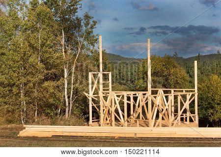 Construction of a wooden house in the woods. Construction of the house. Ecological construction. Construction of family house.