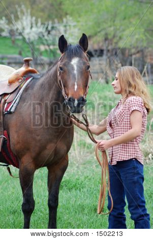 Woman Saddling Horse