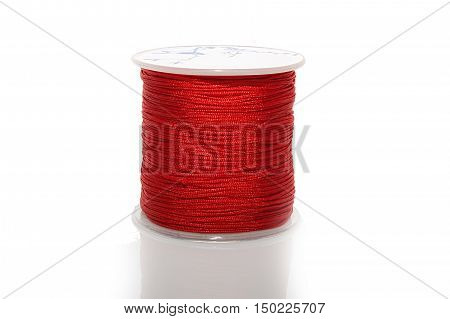 The cylinder of colored cord on white background