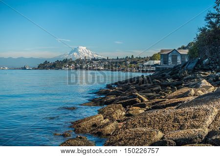 A view of the shoreline in Ruston Washington. Mount Rainier can be seen in the distance.