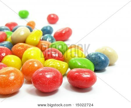 group of colored sweet candies isolated over white background