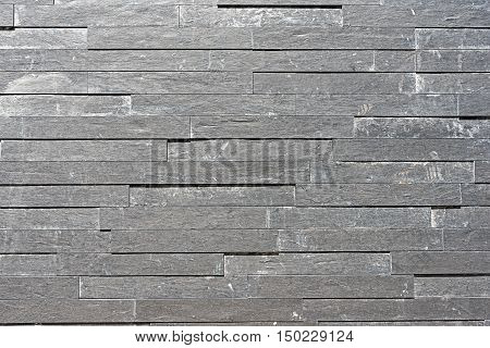 Background from a grey granite tiled wall