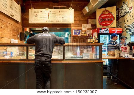 NEW YORK - MARCH 18, 2016: inside of Tres Carnes - 688 6th Ave, New York. Tres Carnes is a barbeque eatery offering authentic Texas Smoked Mexican Fare.