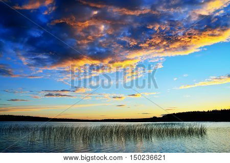Beautiful scenic sunset on the lake Momsayarvi. Karelia Russia