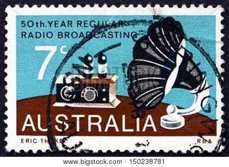 AUSTRALIA - CIRCA 1973: a stamp printed in Australia shows Radio and Gramophone Speaker Broadcasting in Australia 50th Anniversary circa 1973